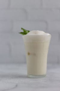Vegan Turkish Yogurt Drink with mint garnish in clear glass